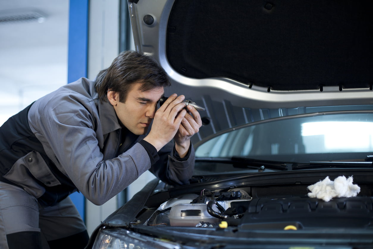 image of mechanic checking antifreeze